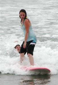 Lynette surfing